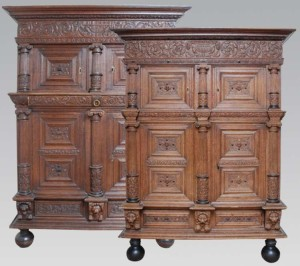 One of a pair of massive oak cupboards extremely fine carved, the front of the cupboards are decorated with classical pillars with Ionian tops and Doric bases.